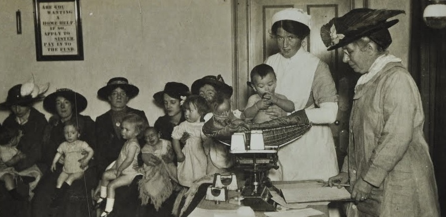Baby weighing, nurse superintendent, c. 1920
