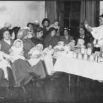 Advising mums feeding c.1915 LMA_4314_07_008_0031