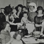 Baby weighing and wealthy visitors c.1930 LMA_4314_07_001_0020