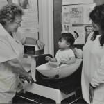 Baby weighing c.1980 LMA_4314_07_008_0020
